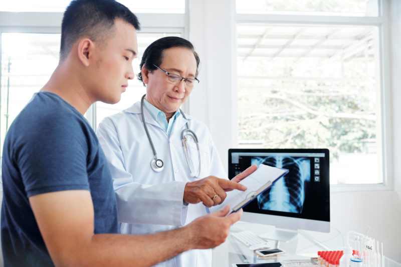 asian doctor explaining medical results to asian patient