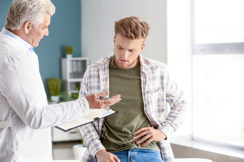 patient at neprologist looking very concerned over results with doctor