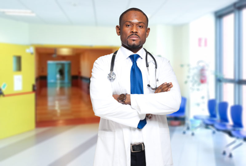 african american doctor crossing arms